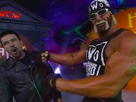 Before his defeat, Hogan was posing and running his mouth with Eric Bischoff. Of note: The nWo Monday Nitro T-shirt on the leader of nWo Hollywood.