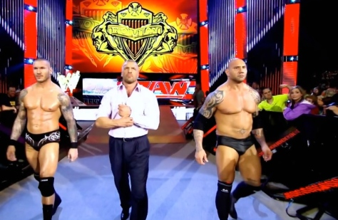 Evolution — Randy Orton, Triple H and Batista — make their way ringside at RAW on April 28.