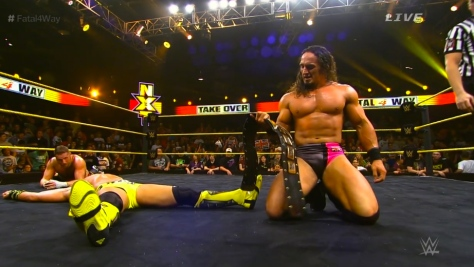 Adrian Neville holds his NXT Championship belt after pinning Tyson Kidd in a 24-minute, 5-star fatal 4-way match. Sami Zayn couldn't get back into the ring quickly enough to make the save.